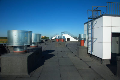 Damp Commercial Roofing - A photo of a commercial roof top.